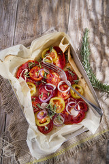Slices of roasted tomatoes and onions