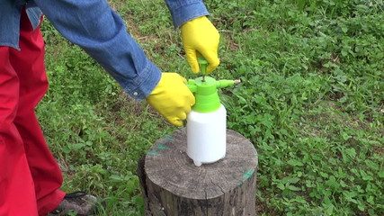 small chemistry pesticide herbicide sprinkler in farmer hands