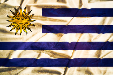 Uruguay  grunge flag on a silk drape waving