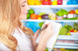 Cute housewife writing list to supermarket