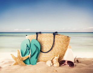 Sandy beach with accessories and blur sea