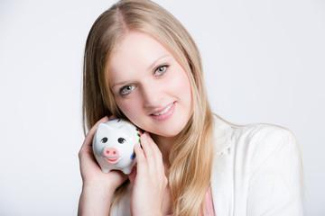 Mädchen mit Sparschwein