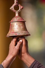 Ringing buddhist bell in nepali temple