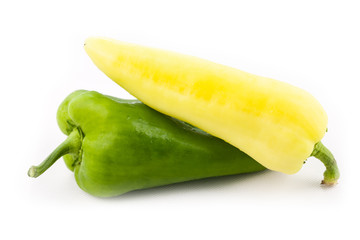 Yellow and green paprika isolated on white