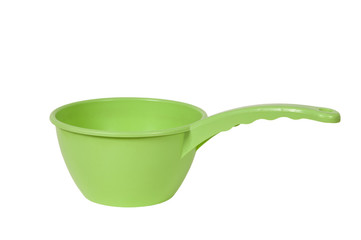 Green empty plastic scoop on white background.
