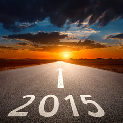 Driving on an empty asphalt road to upcoming 2015