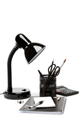Table lamp and office supplies isolated on white background.