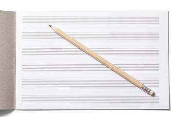 Notebook for Musical Notes and Pencil