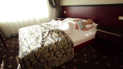 Young Woman Sleeping at Hotel
