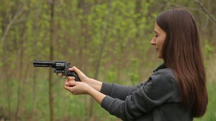 Girl Shoots from Pistol
