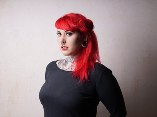 woman with tattoos and piercings