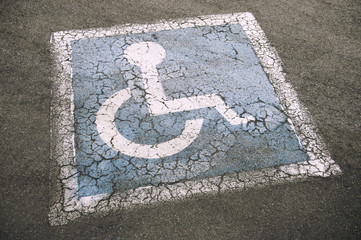 Weathered Disabled Sign in Parking Lot