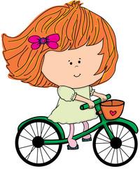 Веселая девочка на велосипеде
