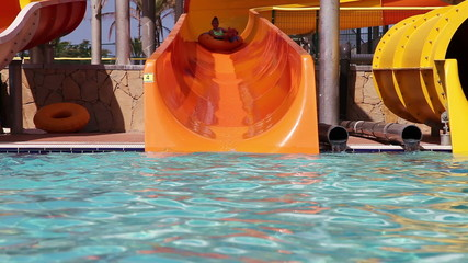 Children have fun with their grandpa in water park
