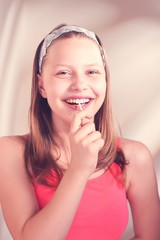 Funny teen girl eating lollypop