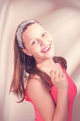 Happy teen girl holding lollipop
