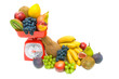 Healthy food - Fresh fruit and kitchen scale on white background