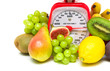 Fruit and kitchen scales close up on white background