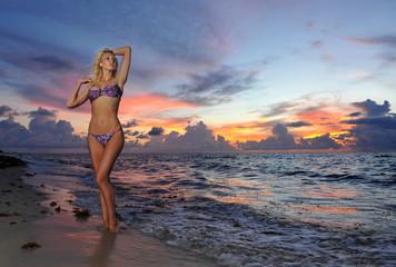 Model posing in bikini at early morning sunrise