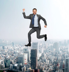 smiling happy businessman jumping