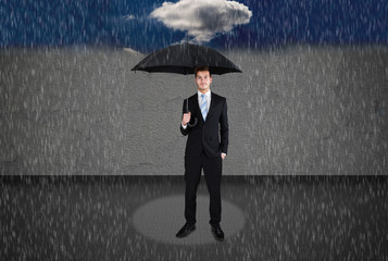 Businessman Holding Umbrella Under Rain