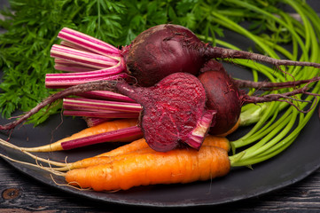 Beets and carrots with leaves closeup