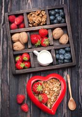 Granola, nuts, berries, milk.  Breakfast.