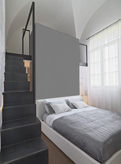 interior view of modern bedroom with iron staircase