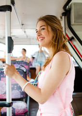 smiling teenage girl going by bus