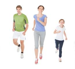 Family Jogging Against White Background