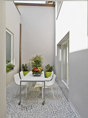exterior view of a modern dining table in the courtyard
