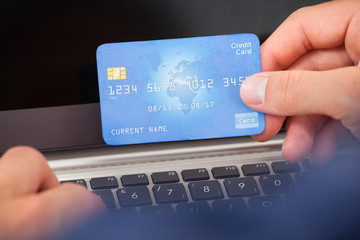 Man Using Credit Card And Laptop To Shop Online