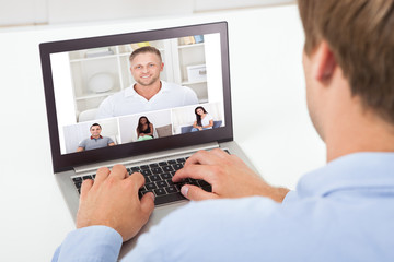 Businessman Video Conferencing On Computer
