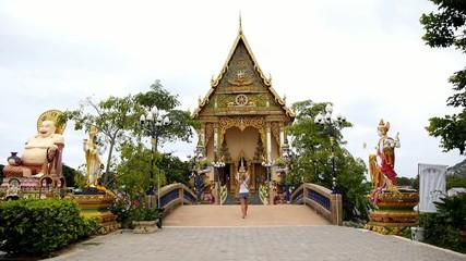 Girl Photographing Buddhist Pagoda, Wat Plai Laem.
