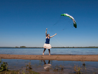 Young woman helds kite