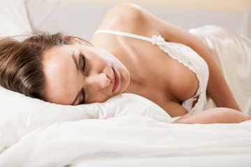 Woman sleeping in sexy underwear
