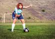 Active pregnant woman playing football