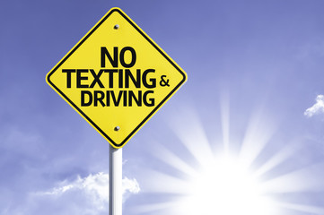 No Texting and Driving road sign with sun background