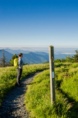 Hiker Taking in the View From Round Bald