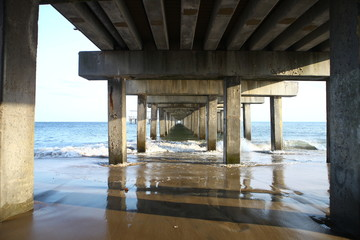 The tunnel under the bridge pier on the ocean