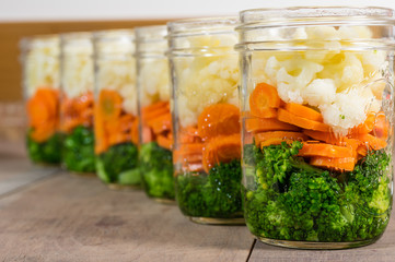 Jars of cut vegetables for canning