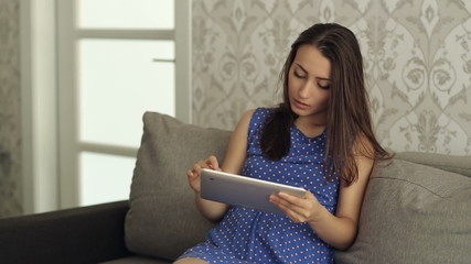 Beautiful Woman With Tablet PC on the Couch