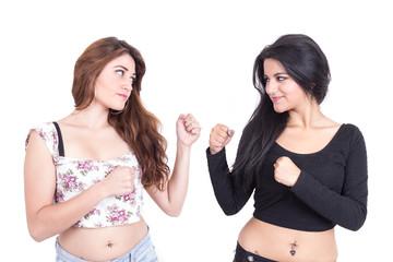 two beautiful young girls posing