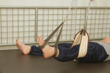 leg exercise with suspension set for rehab muscle strength