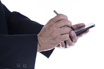 hands with stylus touching the screen of smartphone