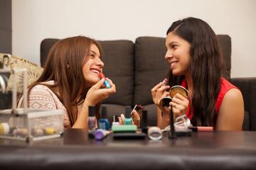 Happy teens wearing makeup