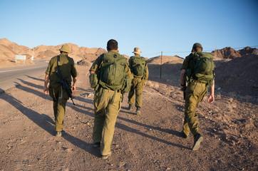 Soldiers patrol in desert