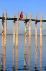 Buddhist monks walking on U Bein bridge, Amarapura, Myanmar