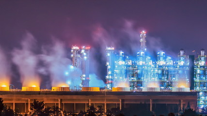 Vapors water from cooling tower in refining plant on night time