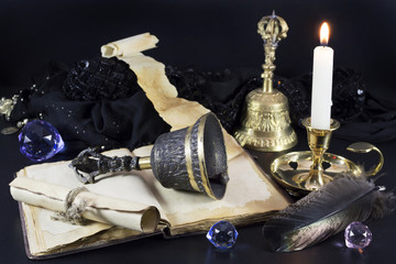 Magic still life with bells and candle